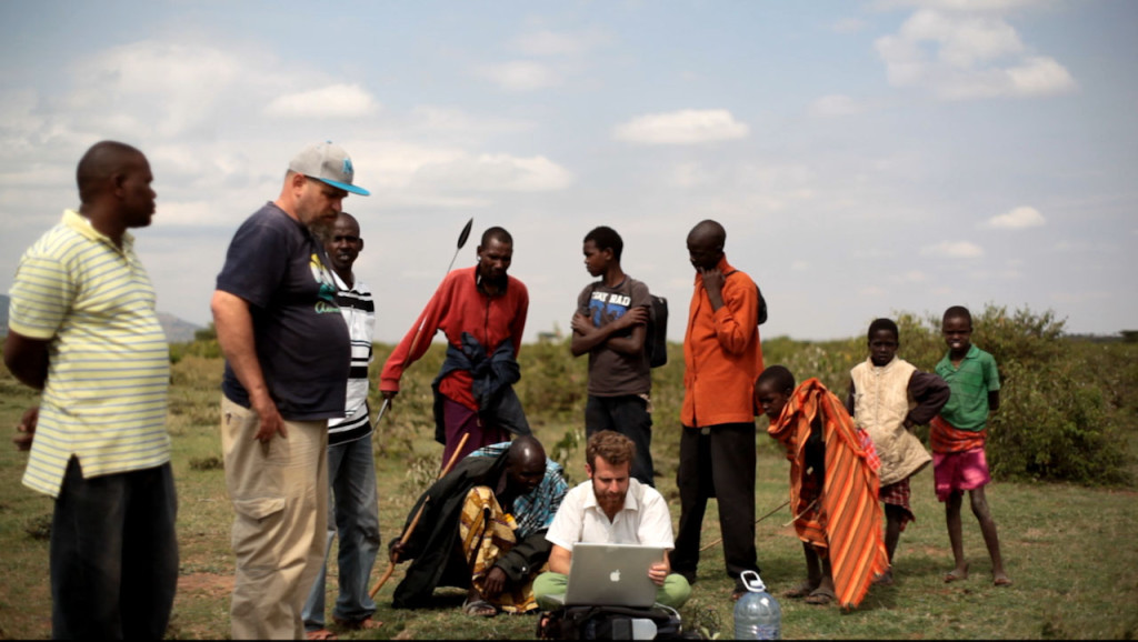 Aviram and Yoav feeding GPS information to the computer to create a map of Sadhana Forest Kenya