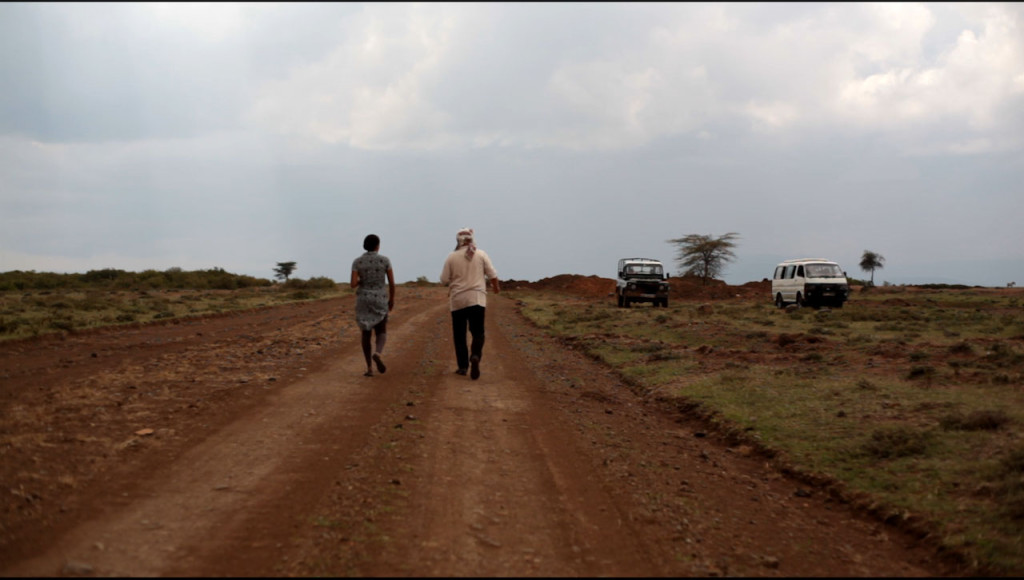 Brooke and Aviram survying the land on road next to Sadhana Forest Kenya