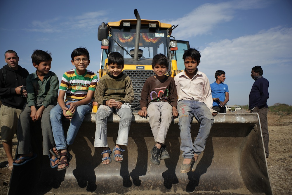 Children on JCB in Luniyakhedi water conservation project