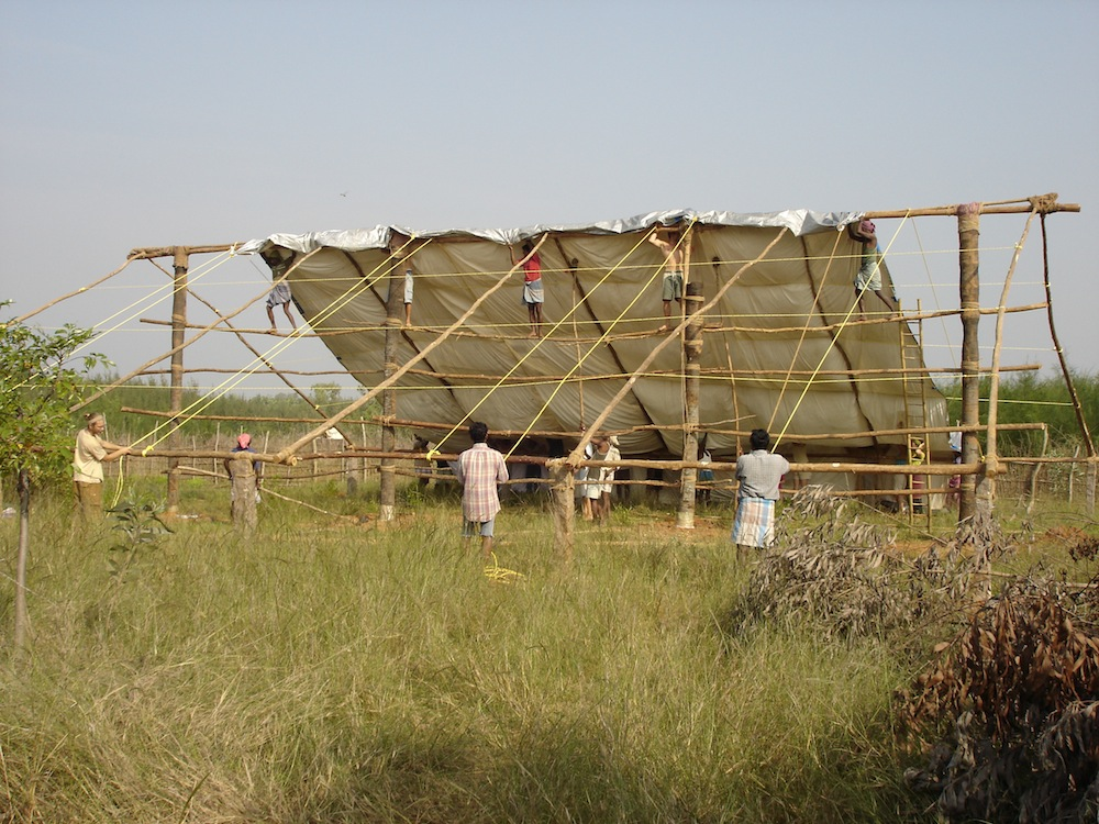 Constructing first dormitory (2)