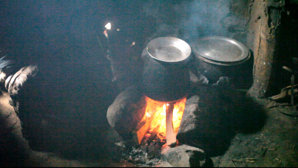 Cooking on open fires inside a Samburu home