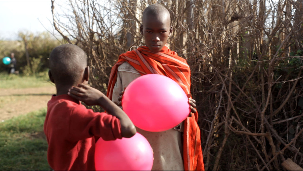 Kids holding baloons next to Sadhan Forest Kenya land