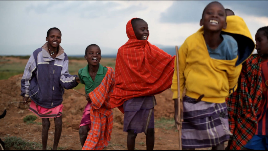 Samburu boys jumping and dancing close to Sadhana Forest Kenya