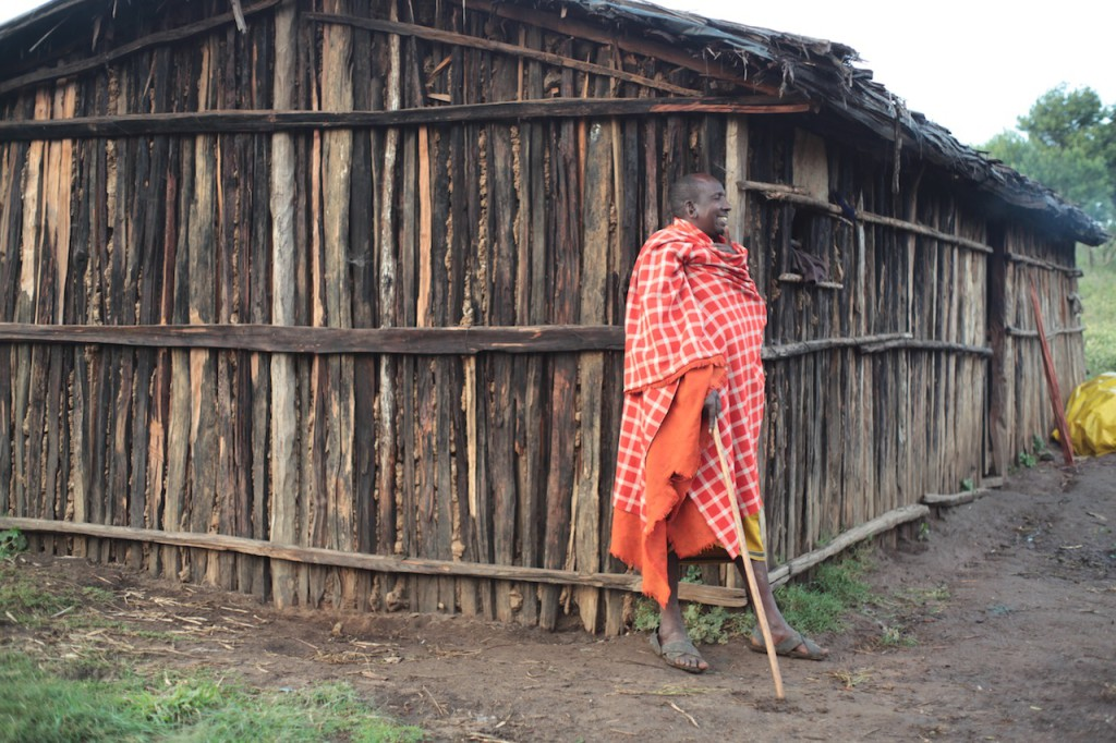 Samburu man outside his house