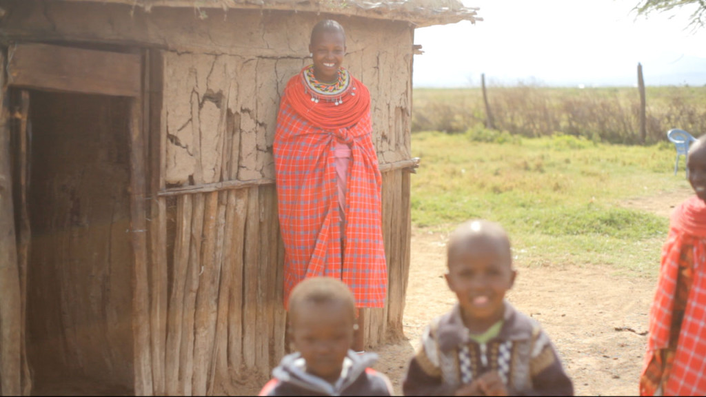Samburu women next to house